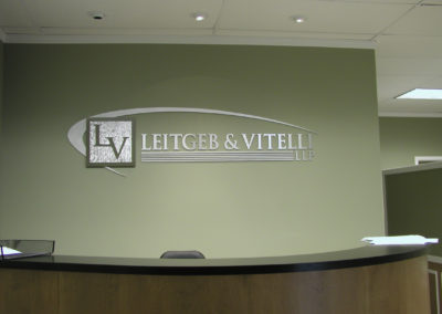 Custom Cut Logo & Logo Type Lettering. Logo Arch Sparkle Grain With Mirror Polished Border. Top Arch Finished Non Directional. Letters Satin Brushed.